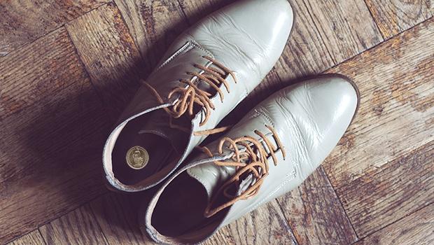Münze im Schuh