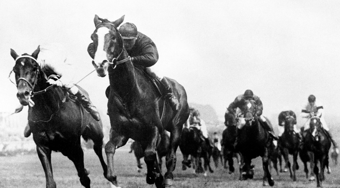 Humorist, second left, comes home to win The Derby.